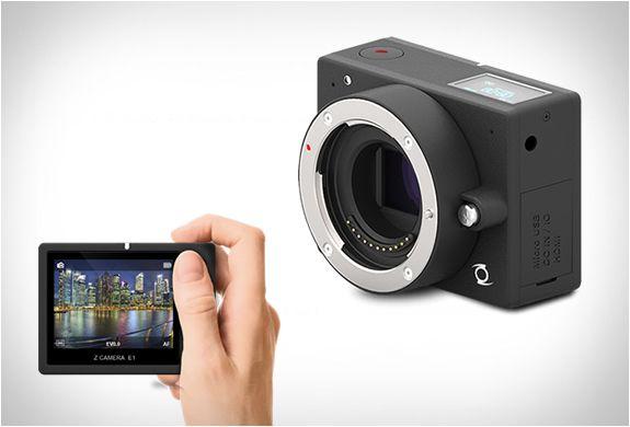 CÂMERA DE AÇÃO - E1 4K ACTION CAM  A Câmera E1 é do mundo dos aparelhos que provoca os fanáticos por fotos, é uma câmera digital com a mais pequena lente intercambiável Ultra HD! Ela dispara em 4K a 24 fps, tem capacidades de ultra-HD, um sistema de lente intercambiável, e é tão fácil de utilizar como uma GoPro.  http://www.filtromag.com.br/camera-de-acao-e1-4k-action-cam/