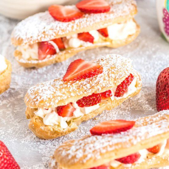 Homemade Strawberries and Cream Eclairs – light and airy pastry filled with whipped cream and fresh strawberries!