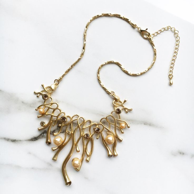 A personal favourite from my Etsy shop https://www.etsy.com/au/listing/479970367/gold-statement-necklace-matte-gold