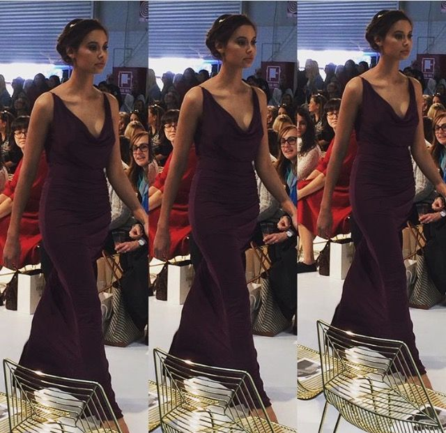 Our Lexie Gown in Plum on the Runway. Now available at Nora and Elle Bridesmaids.