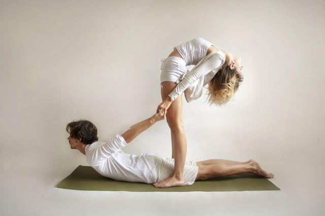 perfect partner yoga poses - back-bending cobra pose.