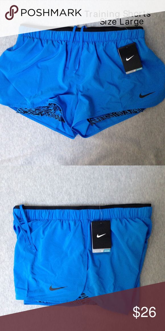 NWT Nike women's training shorts size L Brand new with tags. Authentic Nike! CHECK OUT MY CLOSET FOR MORE DESIGNS SND SIZES! Nike Shorts