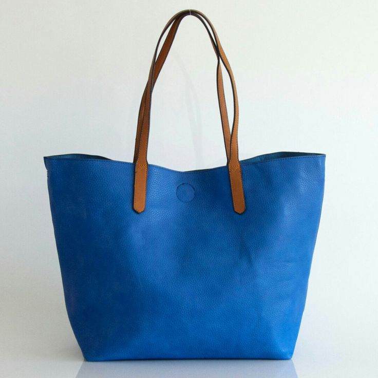 available in so many different summer colors this tote is the best for this season.  very versatile, it is two bag in one, it has a small bag inside that you can use separately with the long cross body strap, or inside the big one