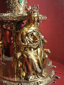Reliquaire de la Couronne d'Épines de 1862 en bronze doré, en argent doré avec des diamants et des pierres précieuses. Détail:Saint-Louis tenant la Couronne d'Épines. Cathédrale Notre Dame de Paris