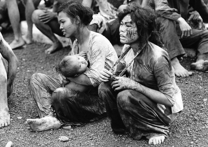 Two women and a child survived the fierce battle in Dong Xoai Day 06.06.1965, physical pain and mental well being on their faces.  http://baobaovephapluat.vn/tin-anh/201504/chien-tranh-viet-nam-va-nhung-hinh-anh-rung-dong-the-gioi-2410622/