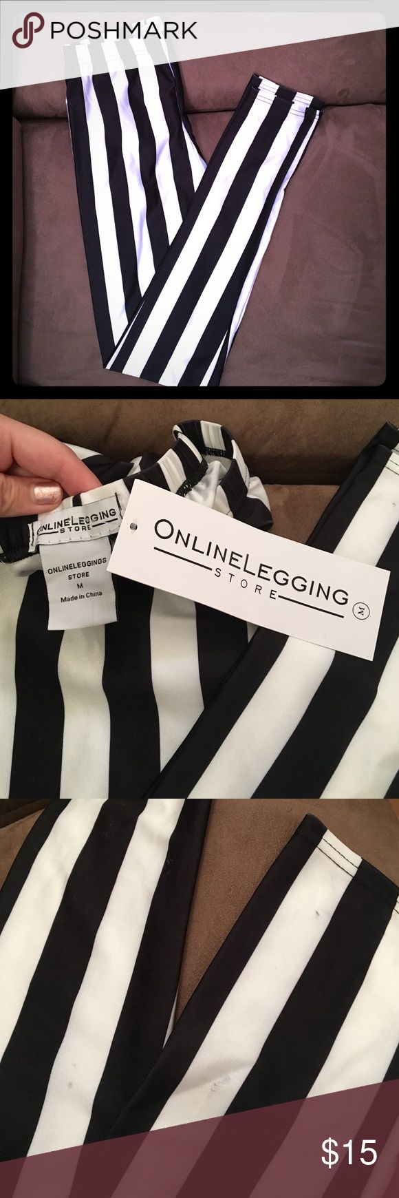 NWT Black & White Vertical Striped Leggings New with tags gorgeous stretchy black and white stripped leggings. Looks killer with a pair of black heels! Also can dress down with flats/sandals. Also can work as killer workout attire. Vertical stripes are very slimming elongating your legs. Did receive with minor defects shown in third photo. Price reflects. Tags still attached. No PayPal or Trading Online Legging Store Pants Leggings
