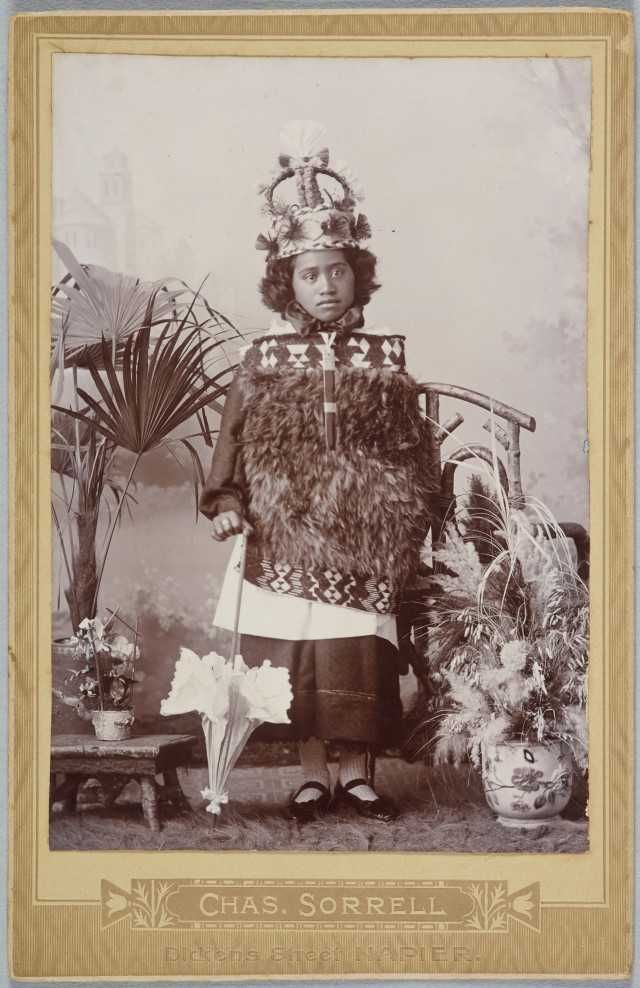 Girl with parasol, cloak and crown. 1880's, Charles Sorrell, Napier. Te Papa Collection