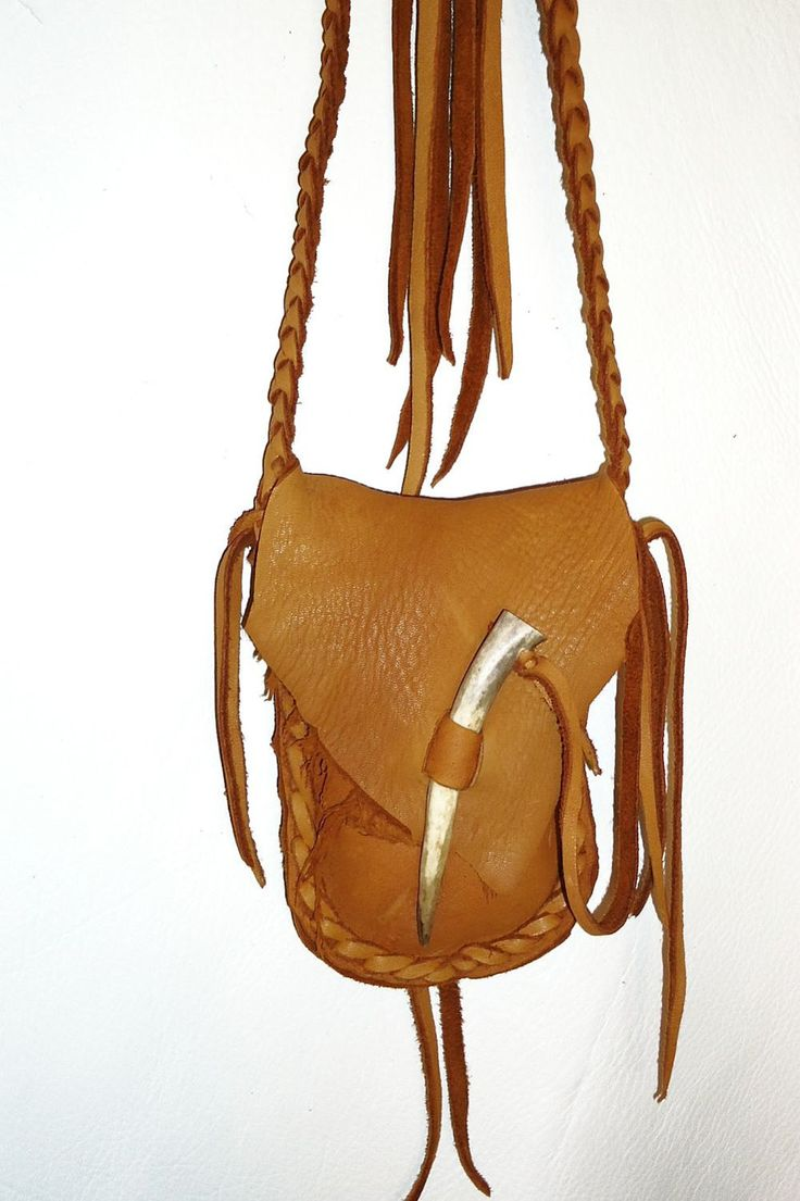 Saddle tan leather medicine bag antler tip closure mountain man. $29.95, via Etsy.