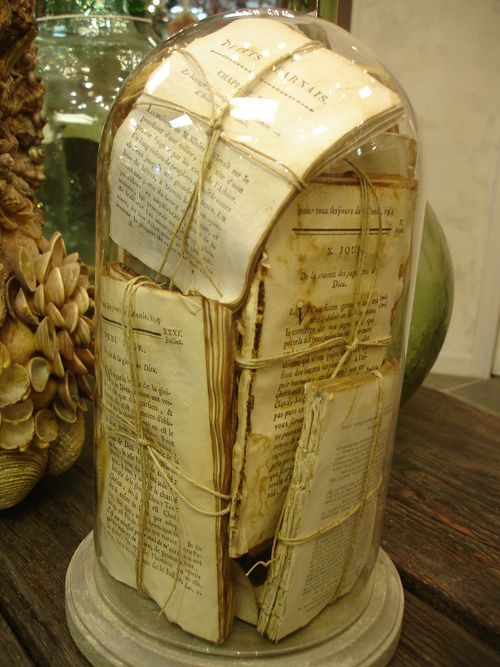 antique glass cloche---  old and tattered French book pages bundled and displayed --lovely...