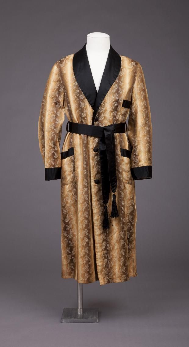 Gold & Beige Smoking Jacket W/Collar, Cuffs, Sash Trimmed In Black Satin. 3 Black Satin Buttons On Front. Fabric Has Tapestry Design 1925-29, Goldstein Museum