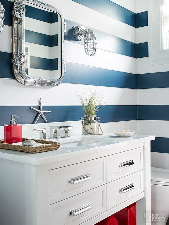 Traditional Americana colors -- red, white, and blue -- can look upscale when thoughtfully incorporated. Bold navy and white stripes make this small bathroom appear larger than it really is. With red accents kept to a minimum, the space feels lively and inviting rather than cliche./