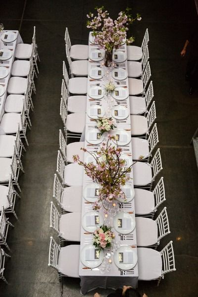 Modern wedding reception decor idea - long, rectangle tables with white chairs + tall, floral centerpieces {Modern Wedding Photography}