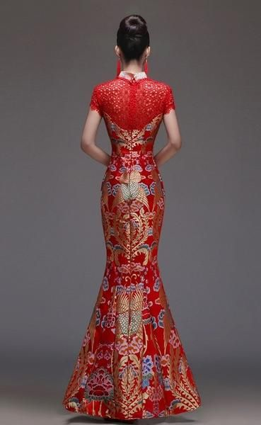 Beaded blooms elegantly phoenix pattern an exquisite tulle gown from the sheer illusion bodice to the wispy evening qipao.Hidden back-zip closure.Slip lining.10