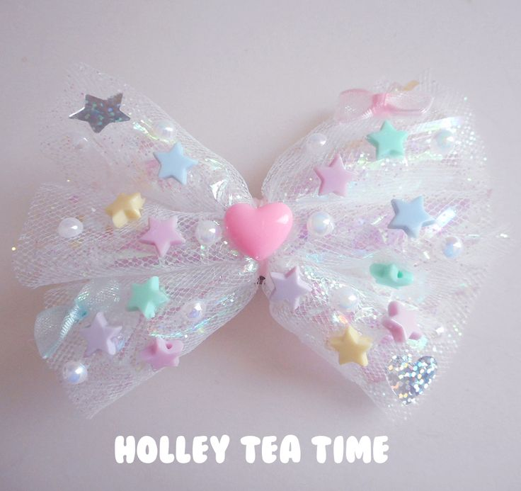"☆ A holographic iridescent dream*¨*•.¸¸⋆*✩  ☆ cute hair bow and pin  ☆ made from magical glitter tulle ,holographic film / cellophane, iridescent bows and stars  ☆ size: 12 cm x 9 cm (4.7"" x 3.5"")  ☆ stars, and false pearls glued on bow ☆ iridescent fairy bows and plastic heart  ☆ Brooch &..."