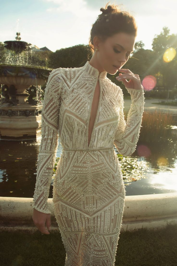 Gown made with carefully placed pearls, long sleeves and a slit at the skirt.   £POA, Ester Haute Couture