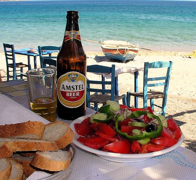 Greek Lunch by tassodikaios,Typical Greek lunch has Always beer, greek sald, fresh baked bread and feta and then whatever main dish you want