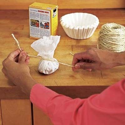 use a coffee filter to hold baking soda for a fridge odor absorber