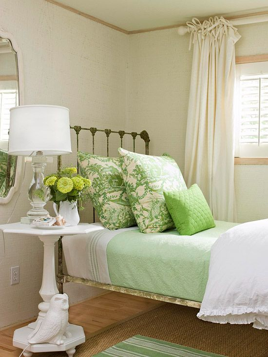 I love the color and the layered linens. The iron bed is sweet and reminds me of my grandmother's home.