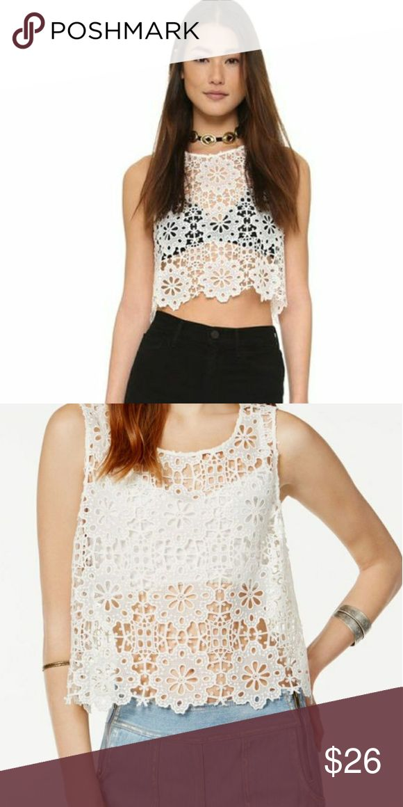 """Free People Crochet Boho Crop See Through Top A slouchy Free People crop top in a floral crochet. Sleeveless, button back keyhole, sheer,  hand wash or dry clean. Measurements taken laying flat: 12"""" shoulder to shoulder, 18 5"""" underarm to underarm, 18"""" long. In great pre-owned condition, no flaws to note. No trades, offers welcome. Free People Tops Crop Tops"""