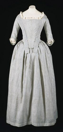 """Robe à l'anglaise: ca. 1775-1780's, American, striped cotton plain weave. """"This gown is a rare surviving example of the type worn by servants and the lower classes, or by middle class women for informal wear. The plain design and the use of cotton fabric are well suited to an informal dress, but also reflect the growing preference for simplicity during the 1770s and 1780s. At this time, dresses with closed skirts became popular; called """"round gowns,"""" they were put on over the head..."""""""