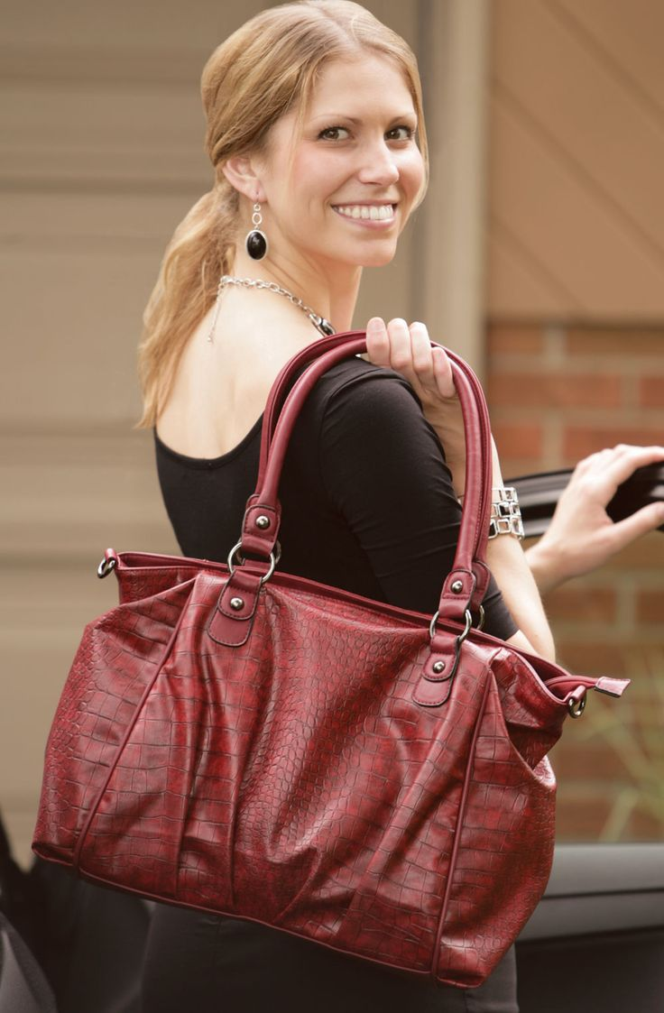 Avery Handbag - This vibrant burgundy handbag features a crocodile textured pattern, hematite coloured metal accessories, removable cross-body shoulder strap, a zippered top closure and outer pocket, as well as a convenient separate zippered interior section, two inner open pockets and a zippered inner pocket. Find out more at www.EverydayStyle.com