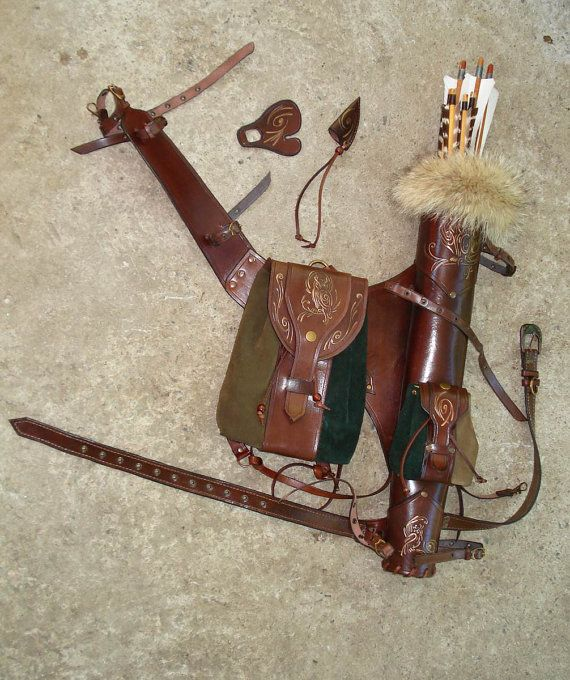 Multifunctional Tooled Leather Quiver Holding a by MadeOfLeather, $400.00