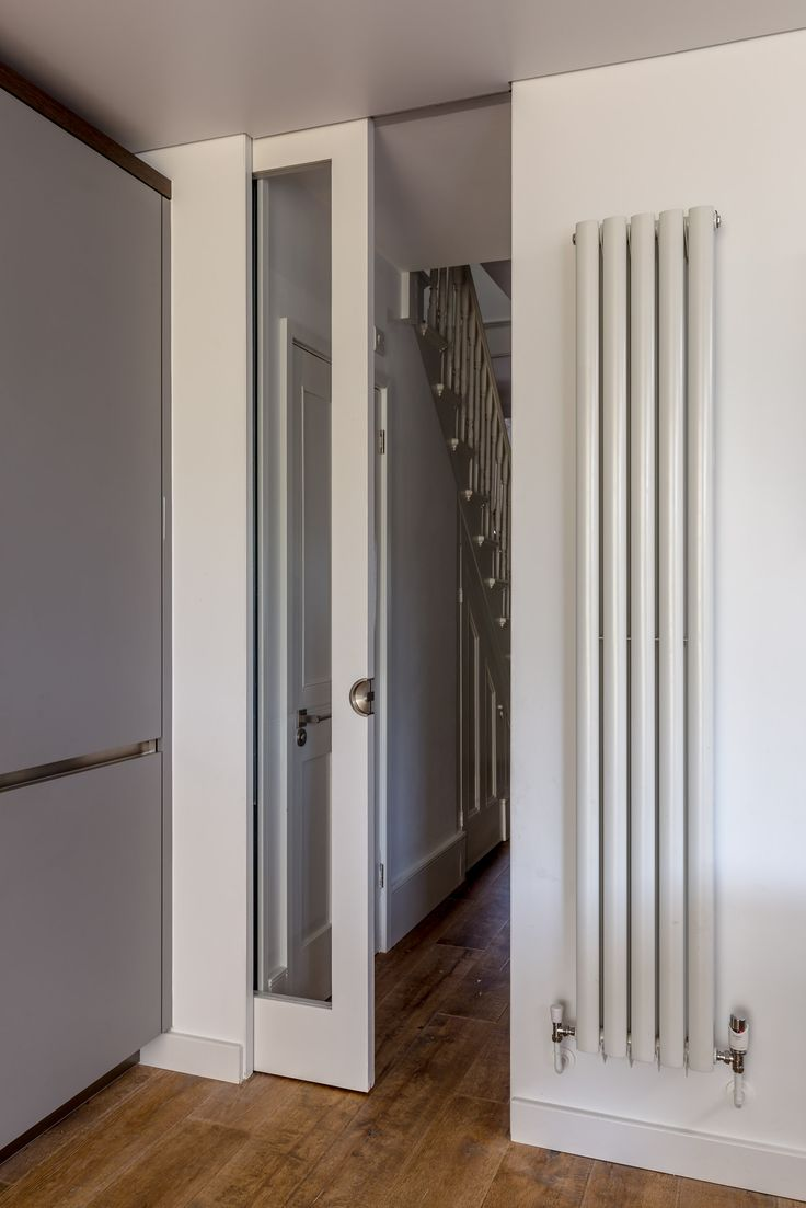 Floor to ceiling glass sliding pocket door  modern tall radiator  Interior Barn Doors  Glass