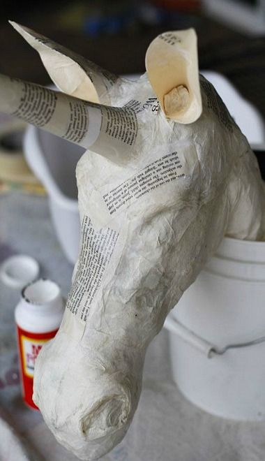 DIY Paper Mache Unicorn Head with mask paper and gold paper