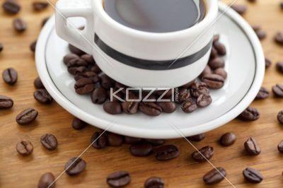black coffee and beans - Black coffee and beans on a saucer