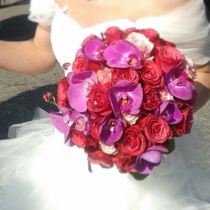 Wedding bouquet with pink roses and orchids Made by Fiori&co.