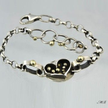 Silver bracelet with a heart.