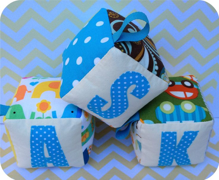 handmade, personalised fabric blocks,soft toys for a baby boy. For details check https://www.etsy.com/shop/evrettou?ref=si_shop