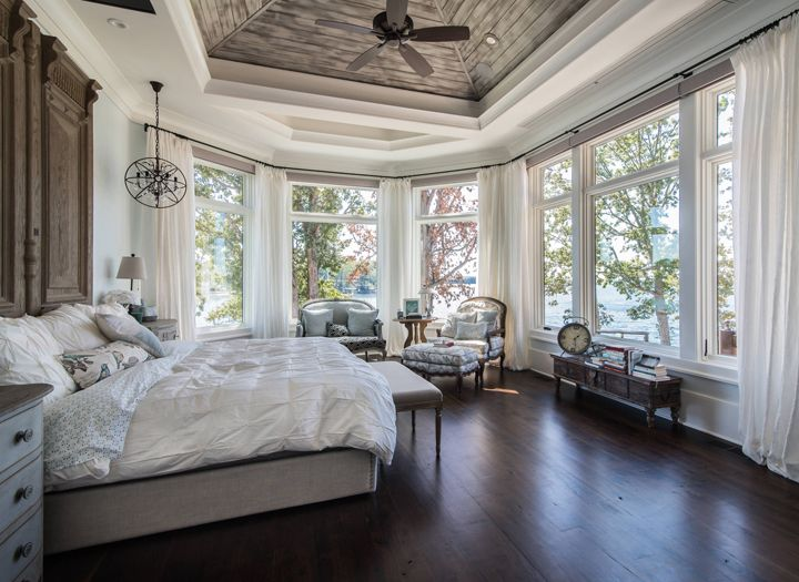 (Now this is an appropriate number of windows for the bedroom ;) Gorgeous  master bedroom (Weber Design Group via House of Turquoise)