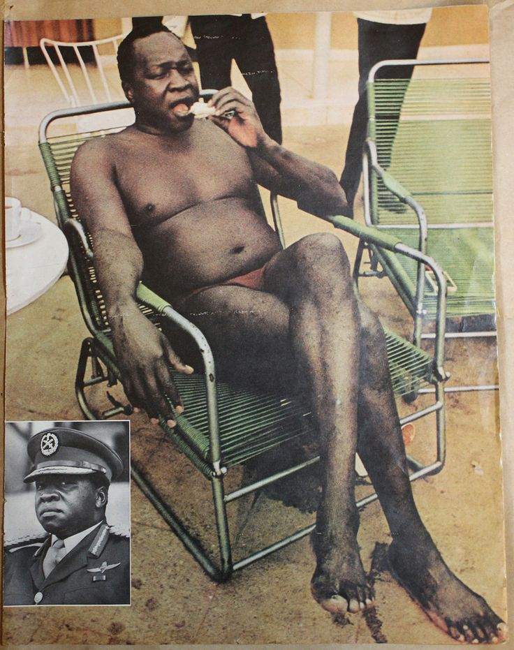 Ugandan dictator Idi Amin wearing a speedo, whilst eating a sandwich. Photo credit: Life magazine - December 29, 1972.