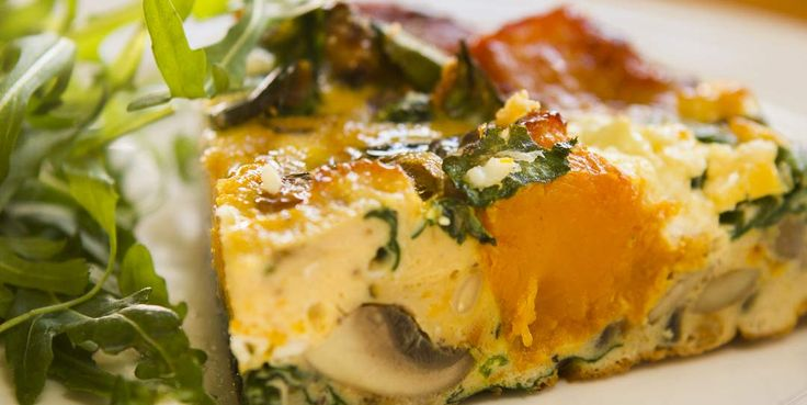 """RUSTIC PUMPKIN AND SPINACH FRITTATA with Greek feta cheese and pinenuts A Frittata is quite similar to an omelette and originated in Italy.  The word """"Frittata"""" is similar to the meaning of """"Fried"""" and is usually cooked in a frying pan. This recipe has roasted caramelised pumpkin that gives it its sweetness, it has the crunch of the pinenuts and the savoury saltiness from the Greek feta.  It's not only an amazingly delicious meal, it's also quite healthy and vegetarian."""