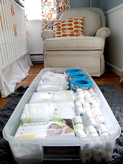 under crib storage with a clear plastic bin. Looks organized and its hidden!
