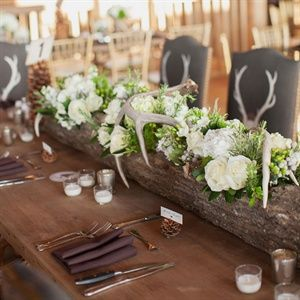 A Rustic Lodge Wedding in Ridgedale, MO - antlers aren't my thing, but I like the place settings.
