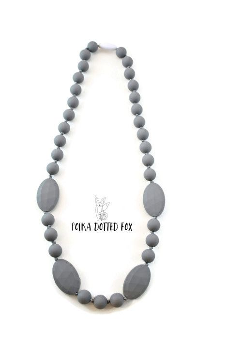 This necklace is sweet, simple, and perfect for a teething baby to nosh on while being fed, held, or for baby to play with while being worn in a carrier or sling. The mix of smooth and textured silico