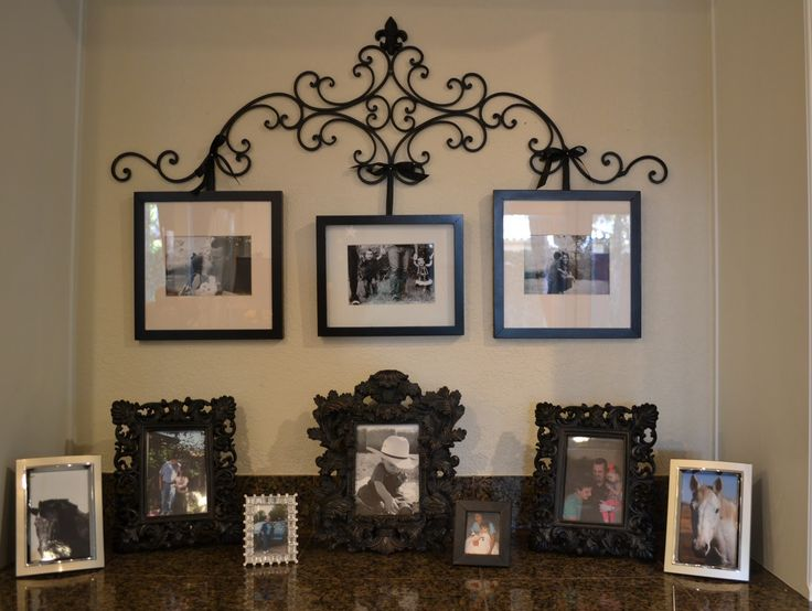 wrought iron picture hanger with revamped frames                                                                                                                                                                                 More