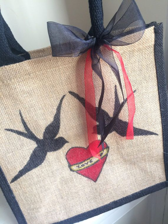 Vintage Swallows Heart Love Tattoo personalised Jute Tote Bag - Sailor Jerry Design Mothers day, Wedding, Birthday Gift.  Hand made to order I can personalise this design with one or two names if you wish. Bag Trim - Black Organza Bow colour – Black or Blue with red accent Print colour – Black or Blue with red The bag is 100% bio-degradable, Eco-friendly and at 30cm x 30cm x 15cm roomy enough to carry all your craft essentials, grocery shopping, uni or college work.  Ali & Harlie x