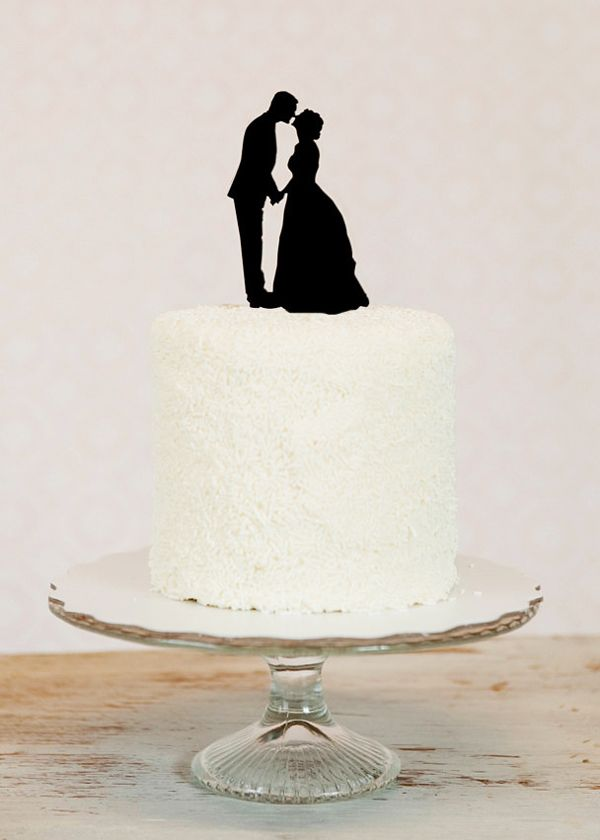 silhouette cake topper....this could be incorporated into/converted to post-wedding artwork for the newlyweds' home.