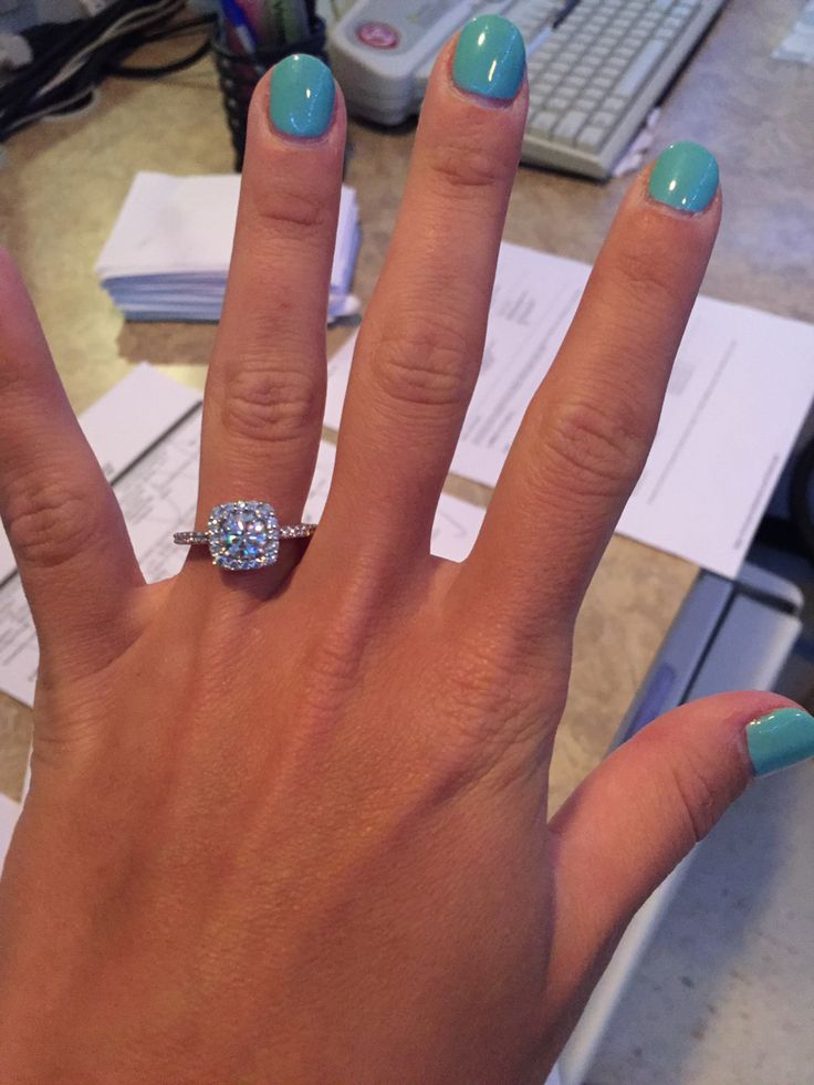Custom Ritani cushion cut halo with 1 carat round center diamond.  I love my engagement ring!