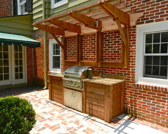 built-in grill on a deck with a different kind of pergola