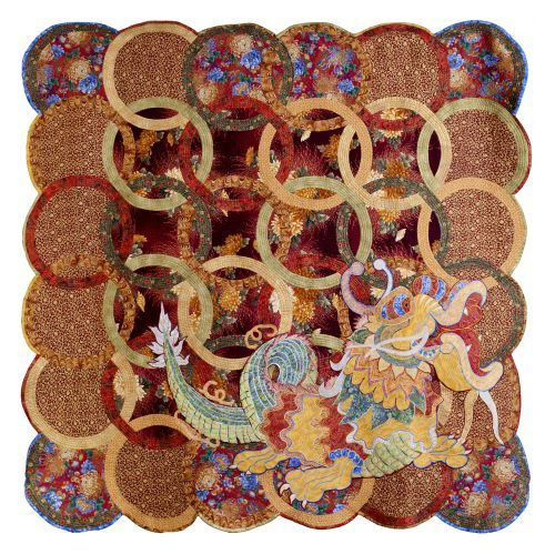 """The Year of the Dragon"" by Sonia Bardella.  Double Wedding Ring quilt with reverse appliqued dragon.  ""Scents of the Orient"" quilt competition."