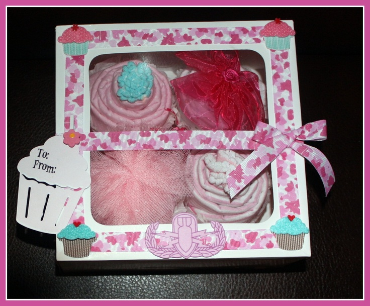 Girl Cupcake Box - Camo  The Cupcake Gift Box for boys includes:    -4 Baby Boy receiving blankets  -4 pairs of socks    (or)    -4 Baby Boy receiving blankets  -4 Burp Cloths or washcloths    Each box can be customized to include any combination of baby items you would like.  Our price: $28.00 (€24.36)