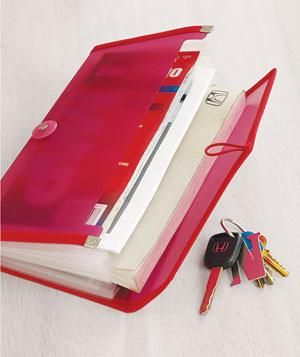 Store your car insurance, registration, manuals, and maps in a neatly bound holder to avoid an avalanche of papers every time you reach in for your sunglasses. It's the first step to getting your car chaos under control.