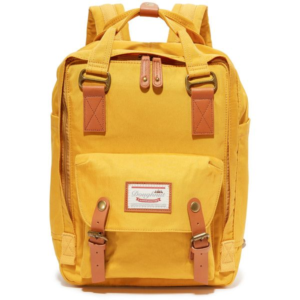 Doughnut Macaroon Backpack ($80) ❤ liked on Polyvore featuring bags, backpacks, daypack bag, day pack backpack, yellow bags, knapsack bag and rucksack bags