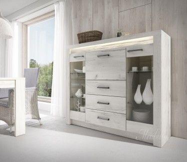 Dressoir Invido is een eigentijds en praktisch dressoir met een landelijke stijl. Dit model beschikt over 2 deuren, 1 klapdeur en drie lades. Het meubel is uitgevoerd in wit en beschikt over LED-verlichting