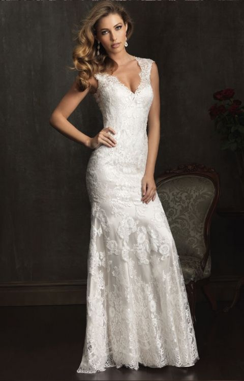 Allure Bridal- 9068: A sexy and sophisticated style in all-over lace. This slim gown features a V-shaped neckline with delicate cap sleeves. The true beauty of this style is the dramatic back.
