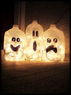 Christmas lights in milk bottles.